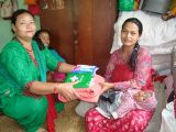 Newly mother receiving blanket, first aid kit from Kumbheshwor CLC.