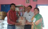 NRC-NFE staff handover relief materials to Chittapole CLC, Bhaktapur